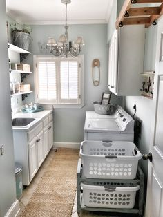 I love every detail of this space - the runner, hooks on the wall, beautiful light fixture, white cabinets, blue walls, all of it!This has to be about the same size as my laundry room at the cabin. I love this space and it could really be great storage! See about working in a small mud cubby area!