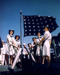 WAVES visiting the USS Missouri (BB-63) in an east coast port, during her shakedown period, circa August 1944. They are standing on the main deck at the bow, with the Navy Jack flying behind them.