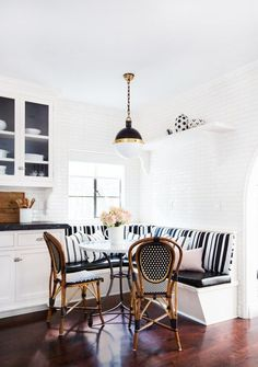 Love that little nook! In the breakfast nook, a pendant from Circa Lighting dangles over a custom-made table by Consort Design and chairs from Maison Midi in Los Angeles. The polka-dot ceramics are by Matthew Ward. Coin Banquette, Kitchen Banquette, Dining Nook, Kitchen Nook, Dining Chair, Kitchen Ideas, Kitchen Decor, Dining Corner, Corner Seating