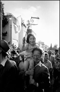 Robert Capa- I chose this photo because it captures the happy mood of the photo really well.