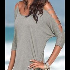"✨New Listing✨ Women's Peekaboo Sleeve Top. Women's sexy half sleeve peekaboo top. Cute details on arms shows the right amount of skin. ⭐️Color is between a khaki & light gray ⭐️Cotton/ Polyester Blend ⭐️Runs True to Size  (If ""applicable"" this item includes sales tax reimbursement computed to the nearest mil') Tops"