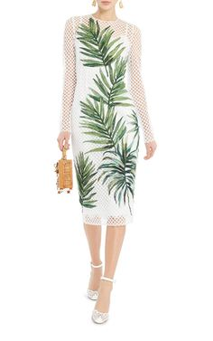 Domenico Dolce & Stefano Gabbana are known for their sophisticated take on femininity, so small wonder this season they deliver this **Dolce & Gabbana** dress, crafted in cross-hatched fishnet with a palm leaf print and a form fitting silhouette.