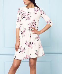 Take a look at this White Floral A-Line Dress today!