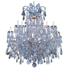 Majestic chandelier with three tiers of lights Swirling crystal arms adorn this magnificent piece Especially great for a large room or grand entry! Chandeliers, Swarovski Crystals, Ceiling Lights, Pendant, Arms, Lighting, Room, Products, Transitional Chandeliers