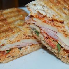 "Deluxe Pizza Panini | ""Paninis make a boring sandwich a gourmet meal. Pizza is a classic dish and can also sometimes become routine. A grilled pizza panini is a creative way to jazz up the boring sandwich and predictable pizza. Great to heat up as leftovers also for lunch the next day!"""