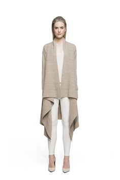 This is the kind of knitted masterpiece born from a true love for knitwear. Channel this oversized cashmere cardigan with simple basics to let it shine and wow with its unexpectedly beautiful pattern. With a draped front and long angled hem, this loose-fitting piece will steal the show even on the most casual days.