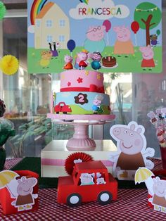 Fantastic cake and decorations at a Peppa Pig birthday party! See more party planning ideas at CatchMyParty.com!