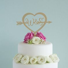 This personalised wedding cake topper features a classic love heart and arrow graphics which can be personalised with the couple's initials. The wedding cake topper is available in either a natural birch wood or a wide range of colourful acrylics.