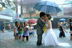 A little weather won't stop these people from getting married.