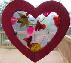 Make a flower heart sun catcher to decorate your classroom for spring.