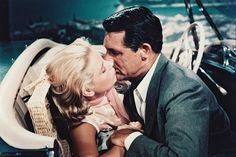 "In her third and final Alfred Hitchcock film, Grace Kelly played opposite Hollywood's suave leading man, Cary Grant. In this scene from the 1955 hit movie, ""To Catch A Thief,"" Kelly and Grant showcase their on-screen chemistry. Alfred Hitchcock, Hitchcock Film, Cary Grant, Grace Kelly, Hollywood Icons, Classic Hollywood, Old Hollywood, Molly Ringwald, Prince Rainier"