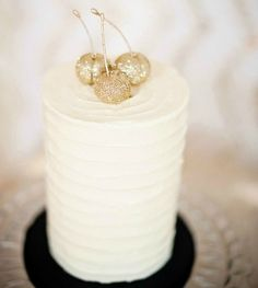 gold glitter cherries on top of an ivory cake? stunning