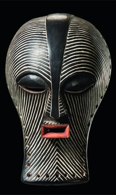 Africa | 'Kifwebe' mask from the Songye people of DR Congo | Wood, kaolin and pigment | This is a female 'kikashi' form of the mask