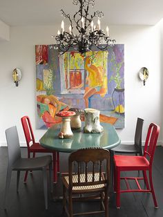 Can't get over the great mix of chairs. Red chairs from recycled Coke bottles, from DWR. Gray molded chairs by Bellini, also from Design Within Reach. And two American nineteenth-century cane chairs.