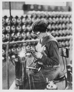 A woman working in a munitions factory during World War One, aiding the war effort whilst the men are away, USA, circa 1914-1918.