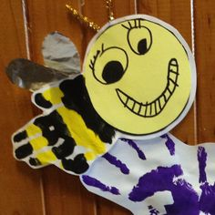 Handprint bees done for a mini beasts theme. We did handprint flowers to go with them!