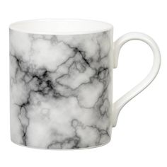 Black Marble bone china mug. Fits under coffee machines for that perfect coffee break. Makes a chic mug for yourself, or as a gift.3 colours available - please see full range.Presented on a neat coffee cup these marbled patterns are ladylike and demure in their presentation. Made from Bone China and decorated in Stoke on Trent these classical mugs are gorgeous individually or as a set of three - Pink, Mint and Black colourways look gorgeous together or on their own.Fine bone china, microwave…