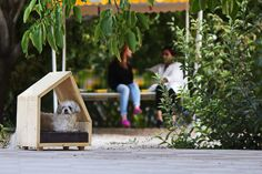 The Crafted Dog House is a modern, wooden hangout spot for your pooch designed by LIDA STUDIO.