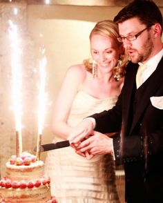 """Instead of the traditional cake topper, opt for sparklers, like Lara and Oliver did at their destination wedding in England. """"It got everyone's attention,"""" Lara recalls fondly."""