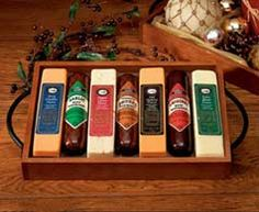 #ML7106 - Simply Delicious Sausage & Cheese Tray.  This gift features a hardwood serving tray with metal handles and contains three varieties of all-beef sausage and four of our finest gourmet cheese bars. $34.99