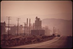 Gypsum plant at Plaster City. White dust from the plant is part of the atmosphere, May 1972