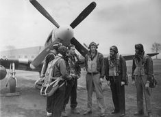 Pilots of the Fighter Group with a Mustang after a mission Image stamped on reverse: 'Barratt's Photo Press. A printed caption was previously attached to the reverse, however this has been removed. Handwritten caption on reverse: 'Boxted. Mission Images, Ww2 Weapons, American Air, Image Stamp, P51 Mustang, United States Army, Luftwaffe, Pilots, Wwii