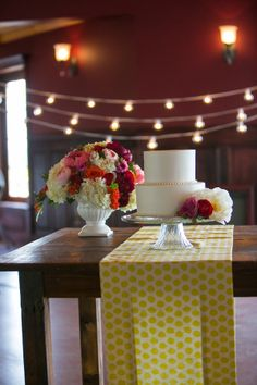 simple and cute cake table #cake #yellow #polkadots http://www.weddingchicks.com/2013/12/27/fanciful-floral-wedding-ideas/