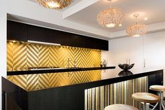 Gold Kitchen back-splash...beautiful, sophisticated and funky!