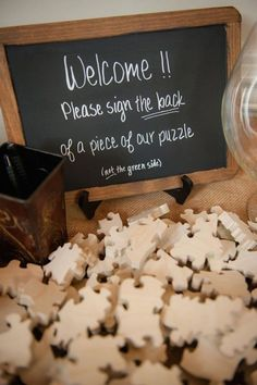 Love the idea of having your guests sign the back of puzzle pieces that you can put together after the wedding!