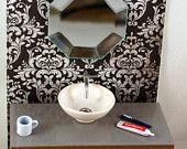 1:16 Modern Dollhouse Jonathan Adler Style White Acrylic Bed. $55.00, via Etsy.