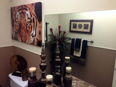 Eye of the tiger, animal print bathroom. Gorgeously designed by Marlene Stotts of Exquisite Interior Decor.