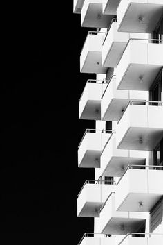 This photograph explores many different design techniques. There is use of balance, repetition, contrast, and perspective. These elements work together to compliment one another to construct a complicated composition
