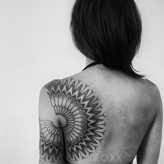 Black and white, geometric, tribal, back tattoo on TattooChief.com