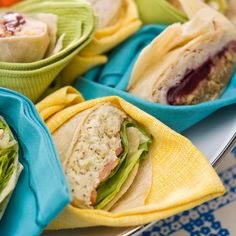 Wrap Individual Servings - Add pops of color -- and decrease the need for paper plates -- by using brightly colored cloth napkins to wrap individual sandwiches on an outdoor buffet tray. Party guests can grab their sandwiches and napkins all at once.  Editor's Tip: If you're serving different types of sandwiches, wrap them in different colored napkins to signify each selection.
