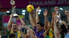 BANGKOK, THAILAND - NOVEMBER 18: Vinicius of Brazil lifts the trophy after winning the FIFA Futsal World Cup Final at Indoor Stadium Huamark on November 18, 2012 in Bangkok, Thailand. (Photo by Lars Baron - FIFA/FIFA via Getty Images)
