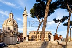 ROME, ITALY - APRIL 11: People sitting on the steps in Piazza Venezia, enjoying the beautiful weather and the warm sunset  - April 11, 2013, in Rome. Stock Photo - 19997324
