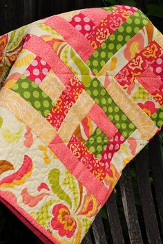 fun patterned baby girl quilt