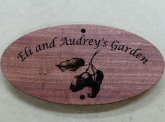 Red gum house sign laser engraved gum nuts and text. Oval shape 350 x 135mm