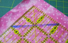 Read the entire blog post. Lots of good info. Line up the 'dry erase' diagonal line with the seam, and trim