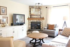 Best paint colour for a warm, south facing room with southern exposure is Benjamin Moore Gentle Cream by Kylie M Interiors. Shown in living room with stone corner fireplace