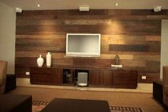reclaimed wood wall. similar to what Kev did in our living room.