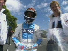 1989 TT. Jamie Whitham in the colours of Durex Suzuki,  with George Dick.