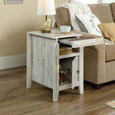 Dakota Pass Side Table in White Plank - Sauder 424119424119 Features: Top molding reveals slide-out shelf with metal slidesDetailed instruction booklet for quick and easy assemblyWhite Plank finishMade in USAFinish: White PlankApproximate Dimensions: Farmhouse End Tables, Rustic End Tables, Narrow Side Table, White Side Tables, Chair Side Table, Lamp Table, Side Table With Storage, Oak Color, Home Furniture