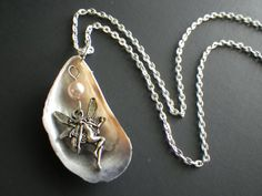 Hey, I found this really awesome Etsy listing at https://www.etsy.com/il-en/listing/199928715/sea-fairy-necklace-mussel-shell-pearl