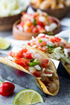 Fish Tacos Tilapia: Tilapia Fish Tacos are mild, flaky, tender, and delicious Tilapia Tacos, Tilapia Fish Recipes, Whole30 Fish Recipes, Seafood Recipes, Mexican Food Recipes, Healthy Recipes, Advocare Recipes, Healthy Wraps, Delicious Recipes