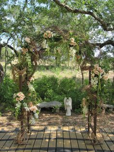 Out door arbor with draping floral treatment.