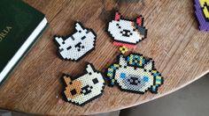 Neko Atsume perler beads by Chemical Vacancy Cats in order are Mr. Meowgi (Osamurai) Ms. Fortune (Koikoi) Peaches (Kurimu) Ramses the Great (Sufin)