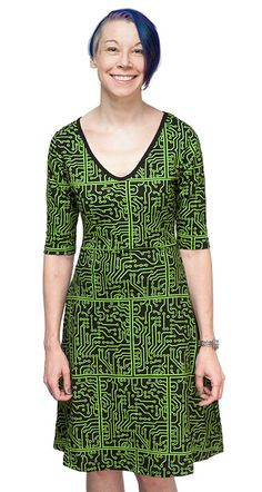 Engineered for awesomeness, the Circuit Board Quarter Sleeve Dress has a scoop neckline, flared skirt and even pockets. Made from 100% organic cotton with a bright green circuitry pattern, this dress is powerfully smart and universally flattering.