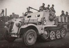 A Demag Sd.Kfz 10/5 light halftrack  with 2cm Flak 38 mounted.