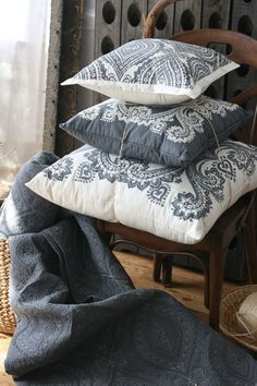 Gray and white pillows. Gray quilt. Lovely vignette.
